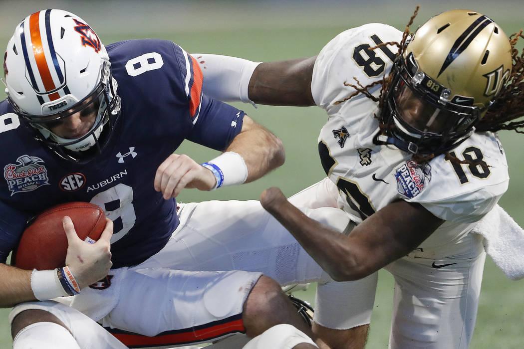 Central Florida linebacker Shaquem Griffin (18) sacks Auburn quarterback Jarrett Stidham (8) during the second half of the Peach Bowl NCAA college football game, Monday, Jan. 1, 2018, in Atlanta.  ...
