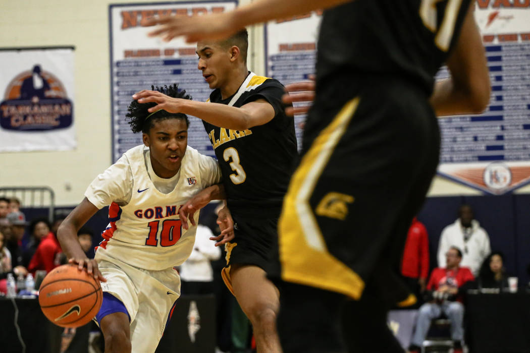 Bishop Gorman's Zaon Collins (10) is guarded by Clark Chargers' Greg Foster Jr (3) during the second half of the platinum division championship basketball game of the Tarkanian Classic at Bishop G ...