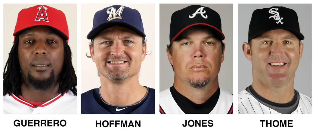 These file photos show baseball players, from left, Vladimir Guerrero, Trevor Hoffman, Chipper Jones and Jim Thome. All four were elected to baseball's Hall of Fame on Wednesday, Jan. 24, 2018.  ( ...