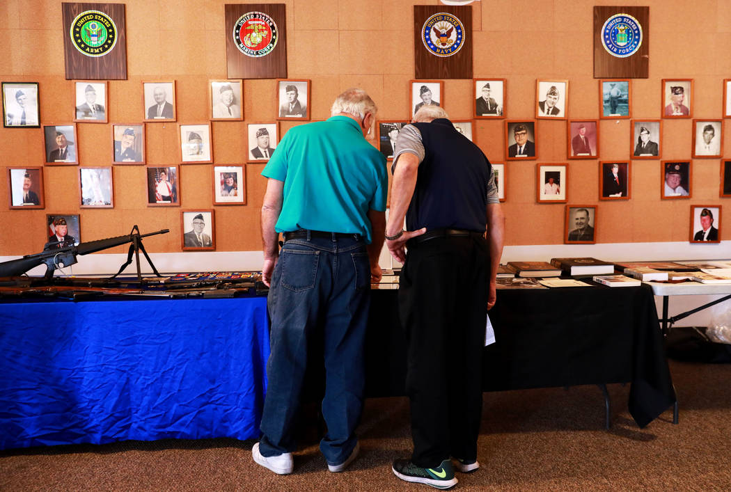 Veteran Robert Davison shows Rod Carlone the different war memorabilia he owns during a 50th anniversary event remembering the Vietnam War Tet Offensive at the American Legion Vegas Post 8 in Las  ...