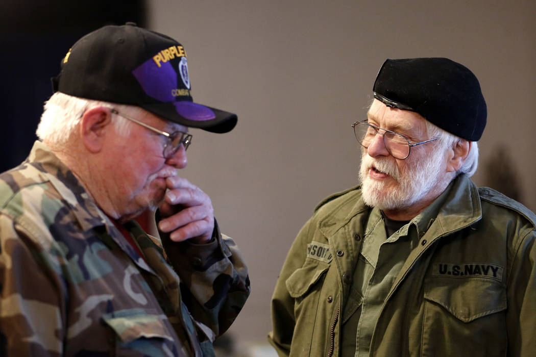 Veterans Bob Haygood, left, and Dean Johnson exchange war stories during a 50th anniversary event remembering the Vietnam War Tet Offensive at the American Legion Vegas Post 8 in Las Vegas, Saturd ...