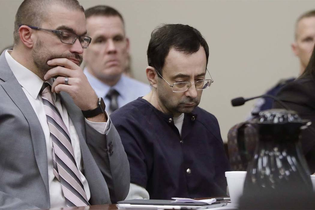 Larry Nassar sits with attorney Matt Newburg during his sentencing hearing Wednesday, Jan. 24, 2018, in Lansing, Mich. The former sports doctor who admitted molesting some of the nation's top gymn ...
