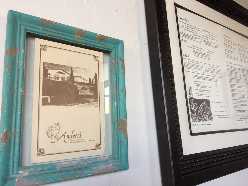 Menus of restaurants past, seen Jan. 2-17, 2017, grace the wall behind the reservation desk at Andre's Bistro & Bar, 6115 S. Fort Apache Road. Chef Andre Rochat has two Strip locations but w ...