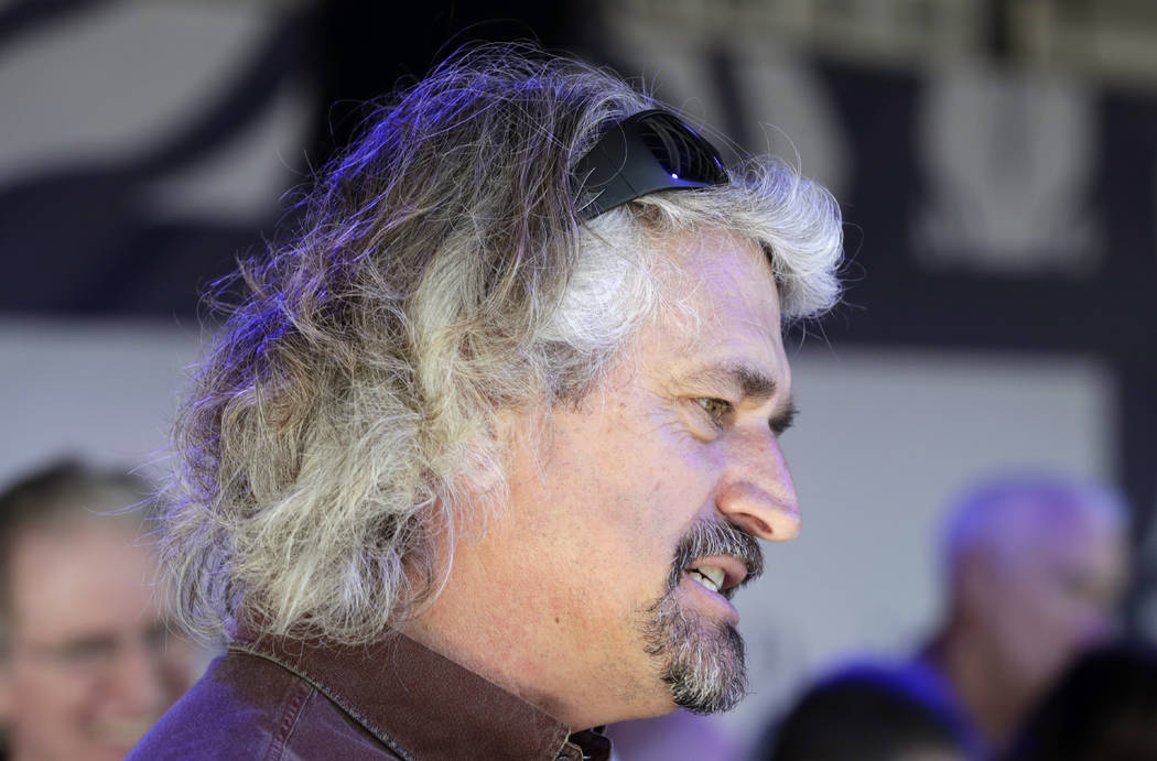 Steve Asmussen, trainer for Gun Runner, is interviewed after the post position draw for the Pegasus World Cup horse race at Gulfstream Park, Wednesday, Jan. 24, 2018, in Hallandale Beach, Fla. The ...