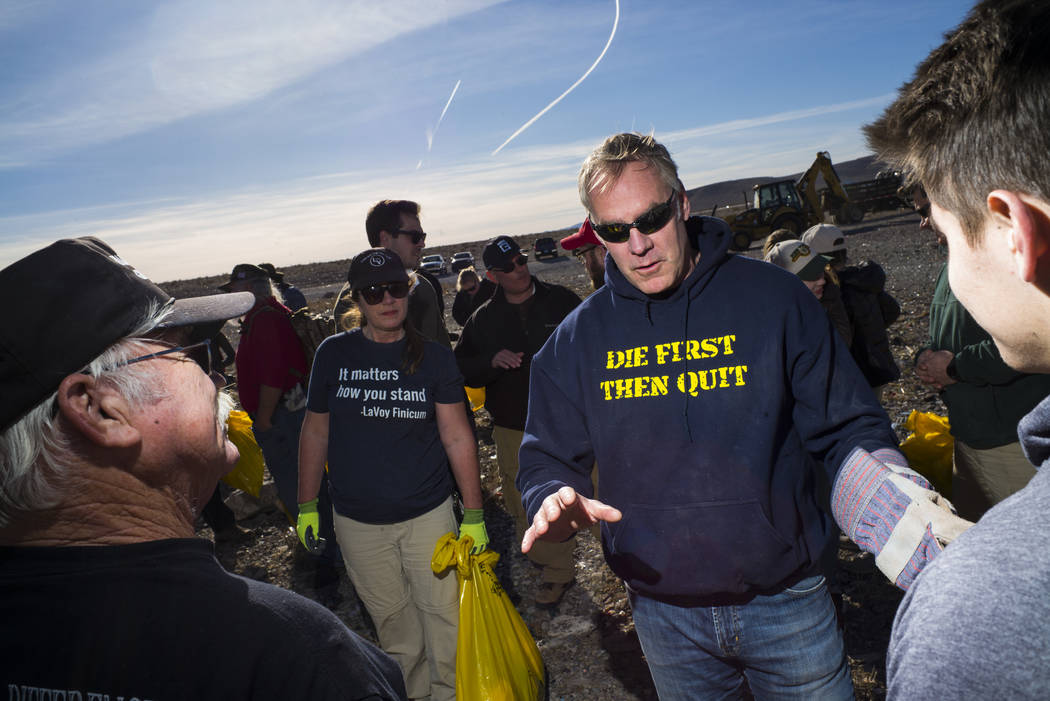Interior Secretary Ryan Zinke talks with volunteers after cleaning up a shooting range area on public land along Las Vegas Boulevard just south of Sloan on Friday, Jan. 26, 2018. Chase Stevens Las ...