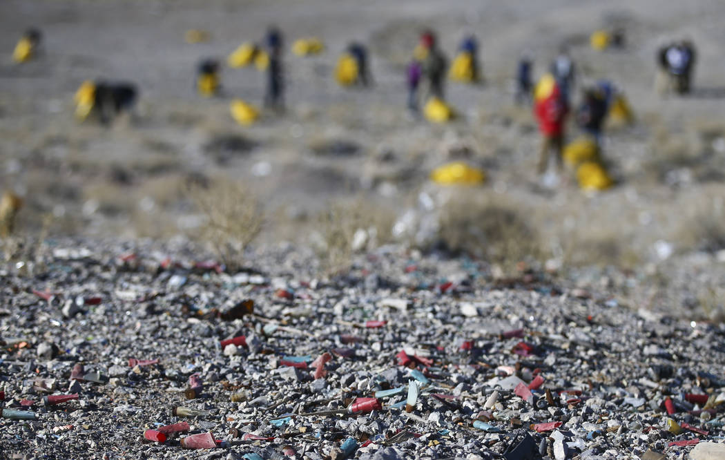 Shell casings and other debris on the ground as volunteers clean up a shooting range area on public land along Las Vegas Boulevard just south of Sloan on Friday, Jan. 26, 2018. Chase Stevens Las V ...