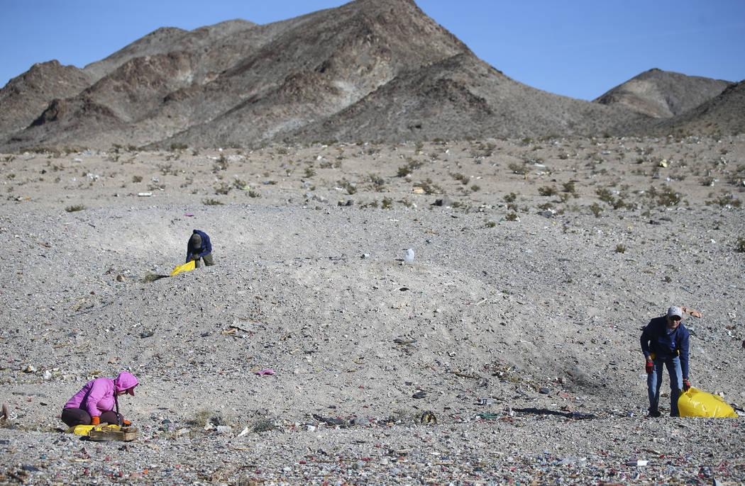 Volunteers clean up a shooting range area on public land along Las Vegas Boulevard just south of Sloan on Friday, Jan. 26, 2018. Chase Stevens Las Vegas Review-Journal @csstevensphoto