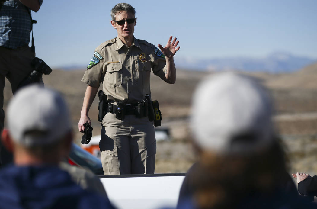Stephanie Clark, chief law enforcement ranger with the Bureau of Land Management in the Southern Nevada District, gives a safety brief to volunteers before cleaning up a shooting range area on pub ...