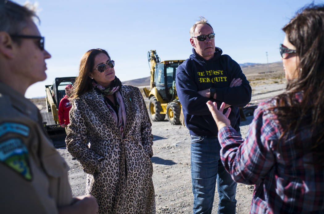 Interior Secretary Ryan Zinke , center right, and his wife Lolita talk with volunteers before cleaning up a shooting range area on public land along Las Vegas Boulevard just south of Sloan on Frid ...