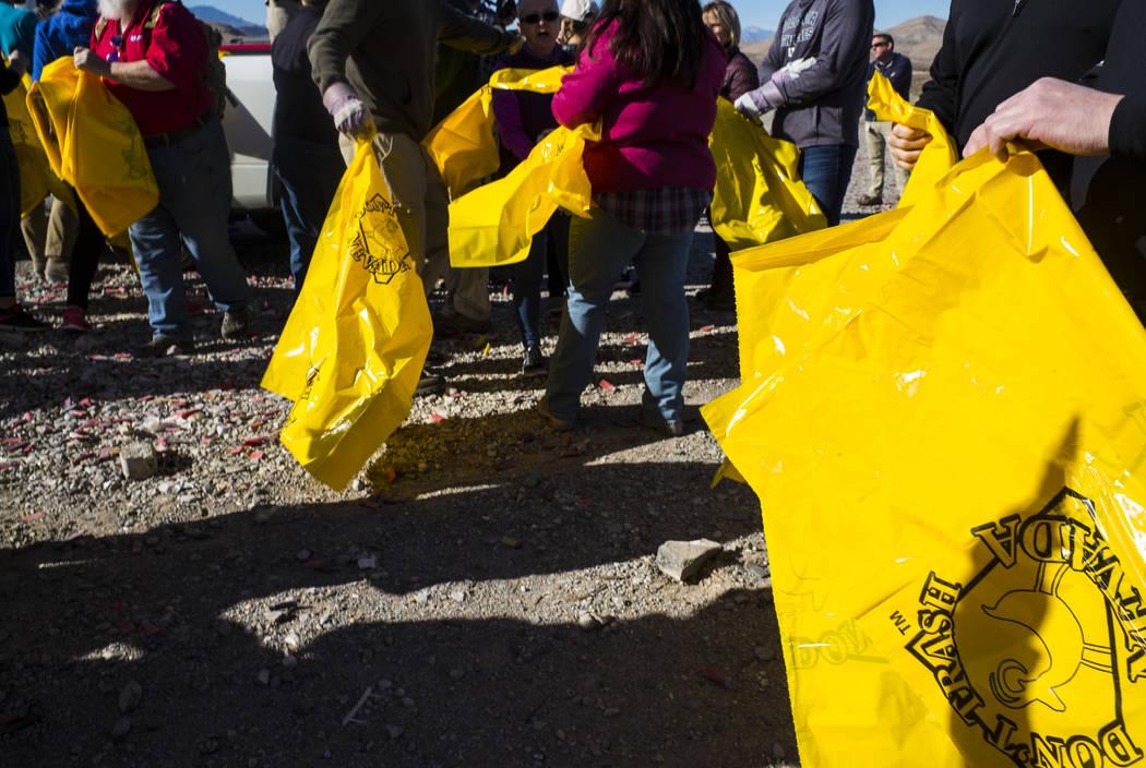 Volunteers prepare to clean up a shooting range area on public land along Las Vegas Boulevard just south of Sloan on Friday, Jan. 26, 2018. Chase Stevens Las Vegas Review-Journal @csstevensphoto
