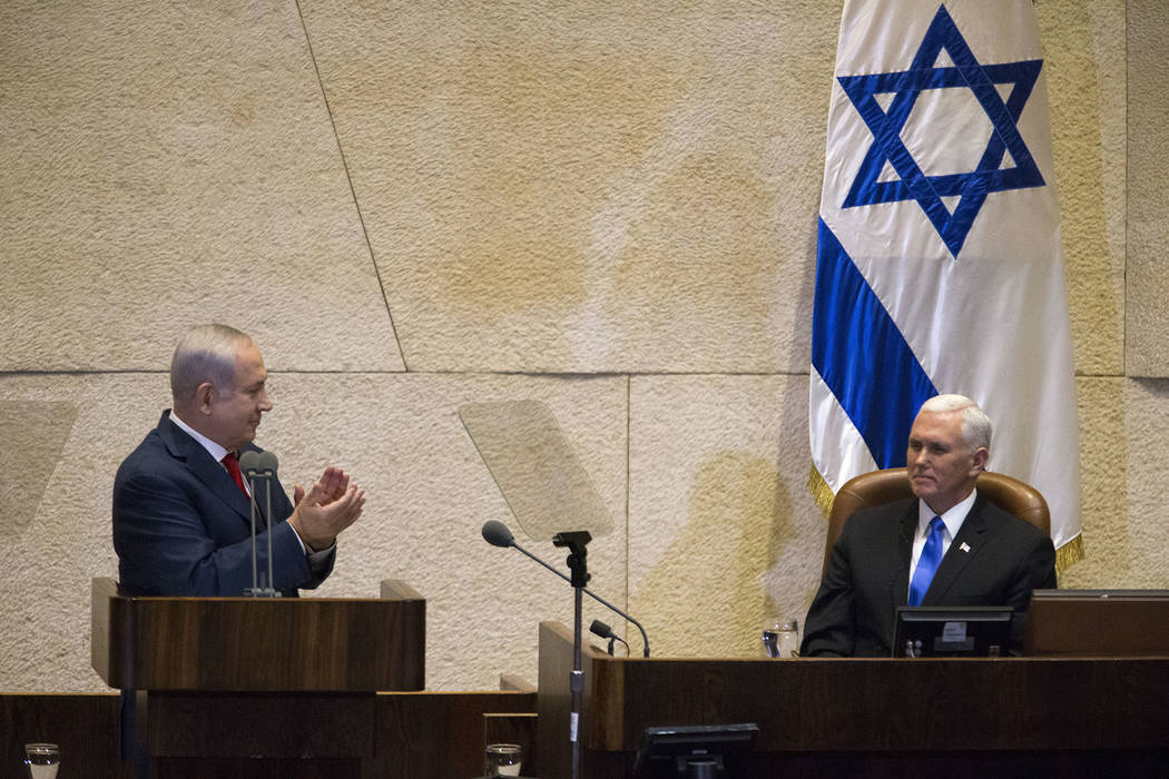 Israel's Prime Minister Benjamin Netanyahu, left, applauds to U.S. Vice President Mike Pence in Israel's parliament in Jerusalem, Monday, Jan. 22, 2018. (AP Photo/Ariel Schalit, Pool)