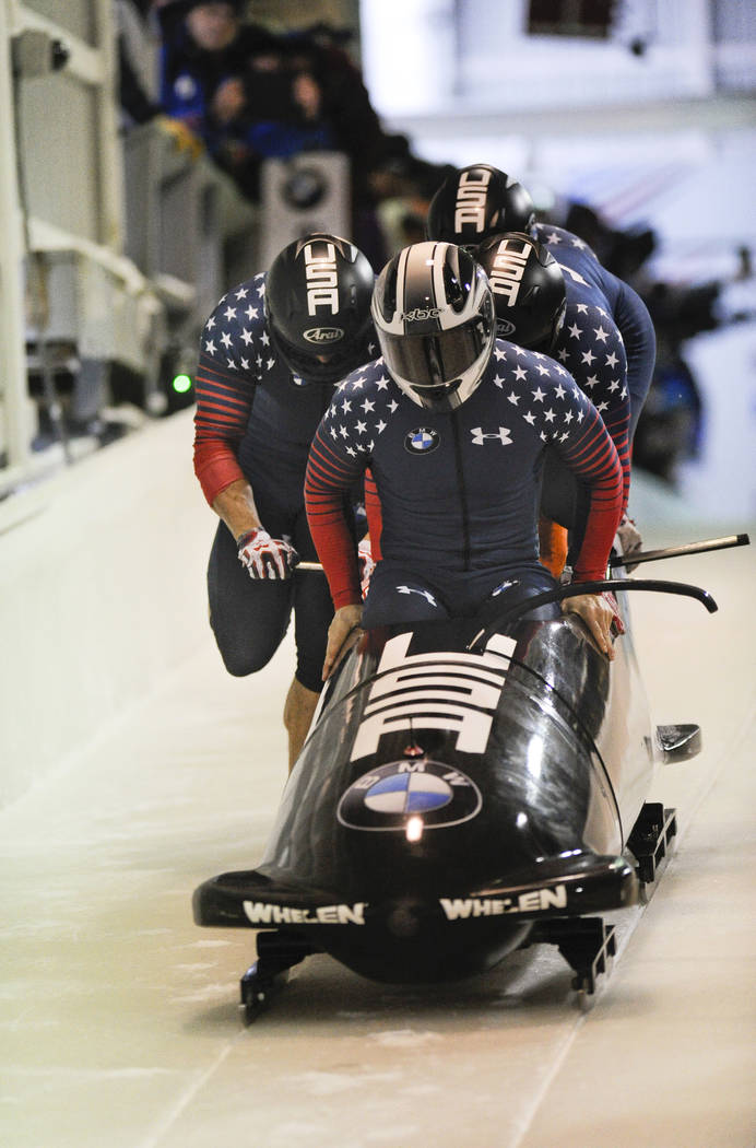 Driver Justin Olsen with Austin Landi, Luis Moreira and brakeman Evan Weinstock, of the United States, compete in the four-man bobsled World Cup race on Saturday, Dec. 17, 2016, in Lake Placid, N. ...