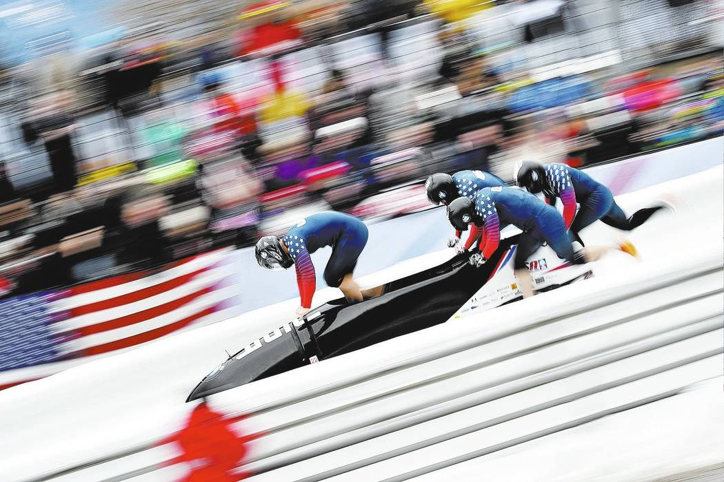 Justin Olsen, left, and his teammates  Austin Landis, Evan Weinstock and Samuel Michener from the United States start their first run of the four-man bob race at the bob World Cup in Igls, near In ...