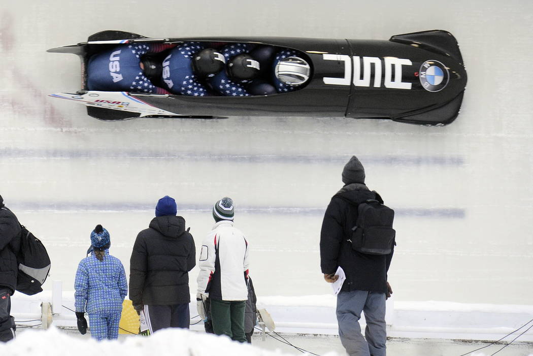 FILE - In this Dec. 17, 2016, file photo, driver Justin Olsen with Austin Landi, Luis Moreira and brakeman Evan Weinstock, of the United States, compete in the four-man bobsled World Cup race in L ...