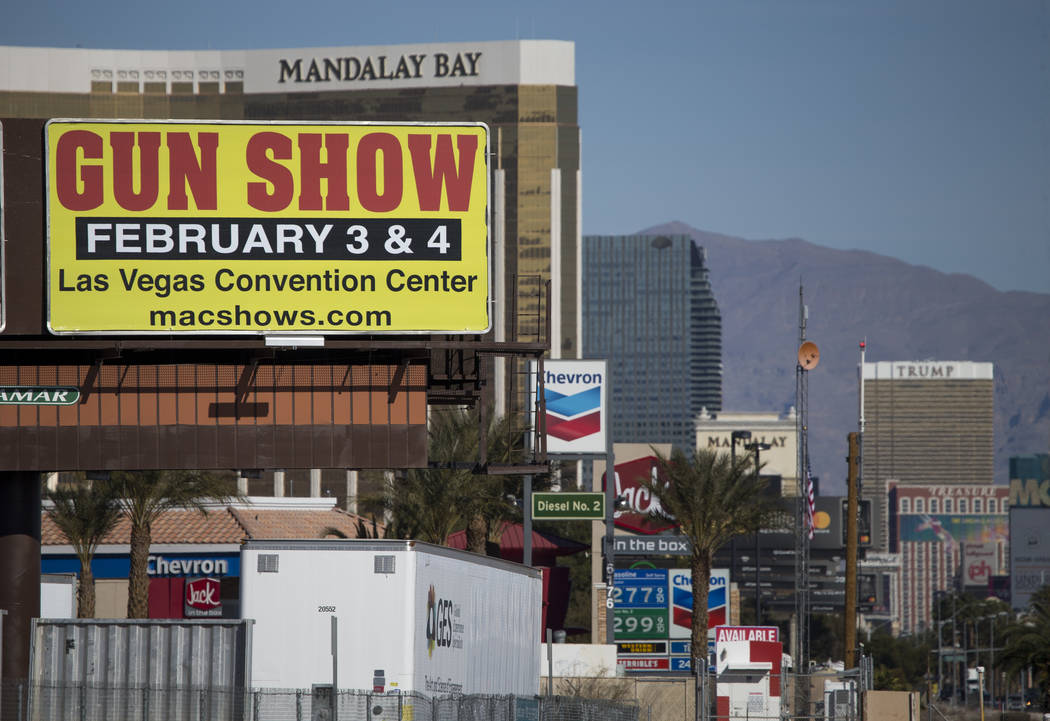 A billboard advertising a gun show is seen along the Vegas Strip south of the Mandalay Bay near the Las Vegas Festival Grounds, site of the Route 91 Harvest shooting, Sunday, Jan. 28, 2018. Richar ...