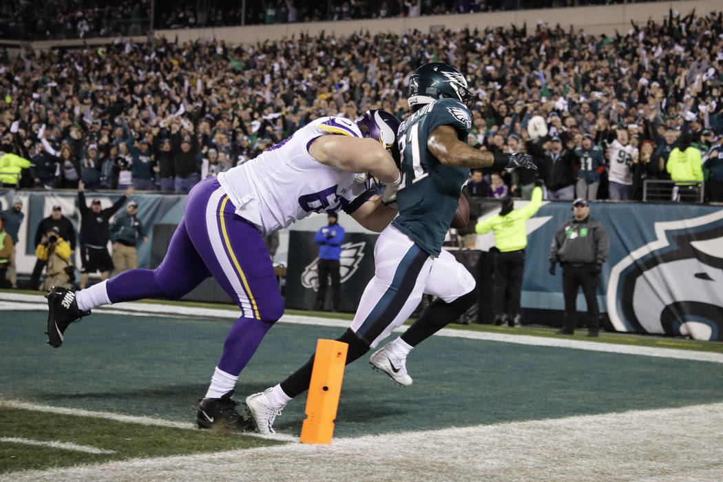 Philadelphia Eagles' Patrick Robinson runs past Minnesota Vikings' Pat Elflein for a touchdown after an interception during the first half of the NFL football NFC championship game Sunday, Jan. 21 ...