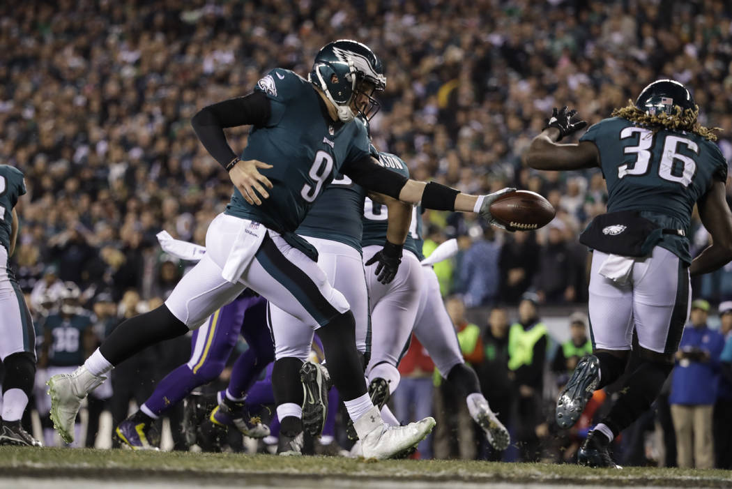 Philadelphia Eagles quarterback Nick Foles hands the ball off to Jay Ajayi during the NFL football NFC championship game against the Minnesota Vikings Sunday, Jan. 21, 2018, in Philadelphia. (AP P ...