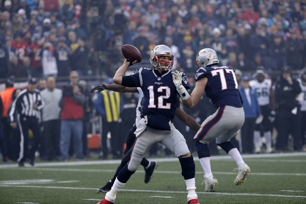 New England Patriots quarterback Tom Brady (12) throws a pass during the first half of the AFC championship NFL football game against the Jacksonville Jaguars, Sunday, Jan. 21, 2018, in Foxborough ...