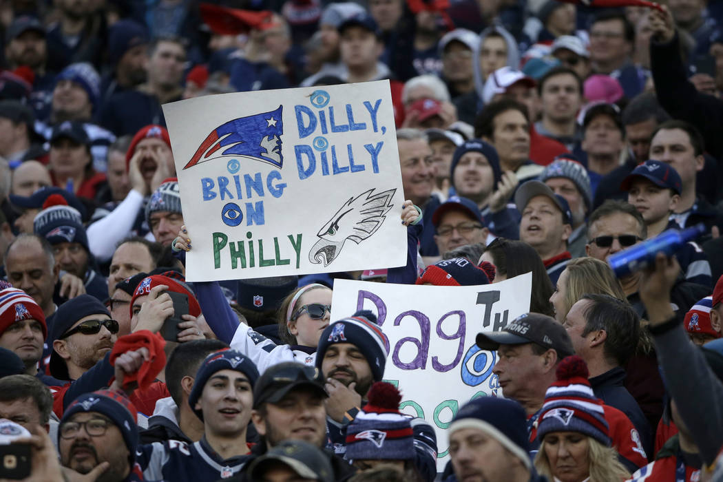 Fans hold up signs during the first half of the AFC championship NFL football game between the New England Patriots and the Jacksonville Jaguars, Sunday, Jan. 21, 2018, in Foxborough, Mass. (AP Ph ...
