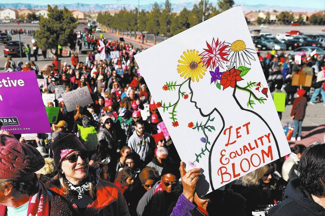 Crowds gather for the Power to the Polls event, hosted by the Women's March, at the Sam Boyd Stadium in Las Vegas, Sunday, Jan. 21, 2018. The event, which served as an advocacy tool to register ne ...