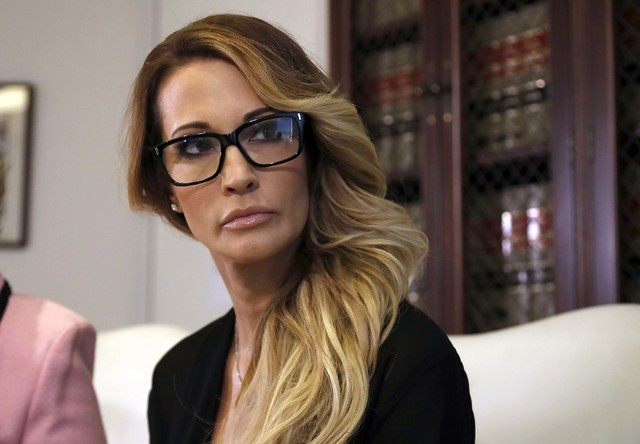 Jessica Drake listens to a question during a news conference at the office of her attorney, Gloria Allred, in Los Angeles on Saturday, Oct. 22, 2016.  (AP Photo/Ryan Kang)