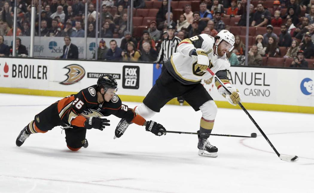Vegas Golden Knights left wing James Neal, right, shoots past Anaheim Ducks defenseman Brandon Montour during the first period of an NHL hockey game in Anaheim, Calif., Wednesday, Dec. 27, 2017. ( ...