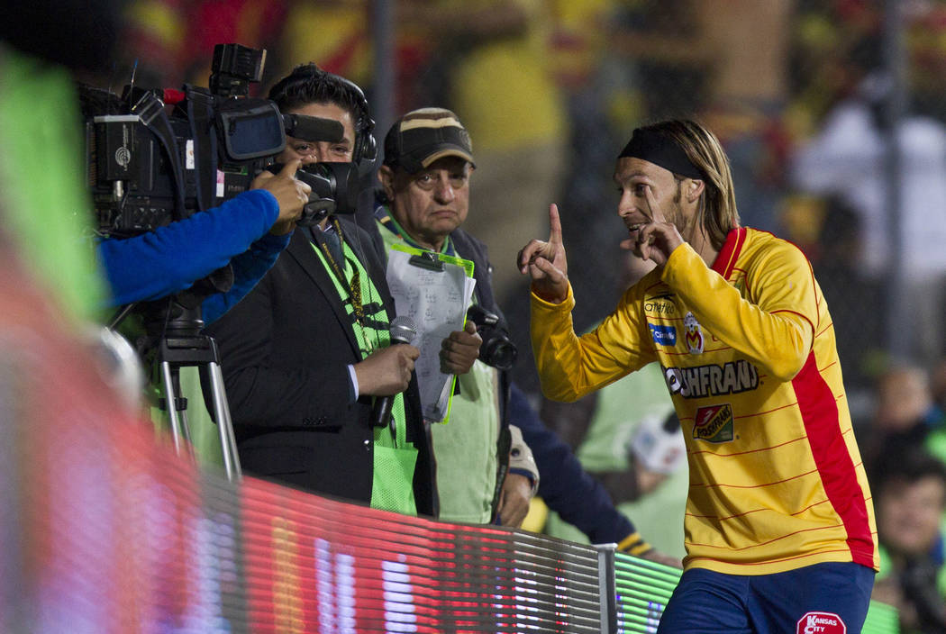 Morelias Gerardo Lugo celebrates after scoring during a Mexican soccer league match against Santos in Morelia, Mexico,  Wednesday, Nov. 30, 2011. (AP Photo/Christian Palma)
