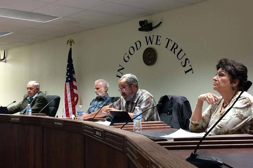 Nye County commissioners Butch Borasky, left, John Koenig, Dan Schinhofen and Donna Cox attend the commission's special meeting on Jan. 10, 2018. (Robin Hebrock/Pahrump Valley Times)