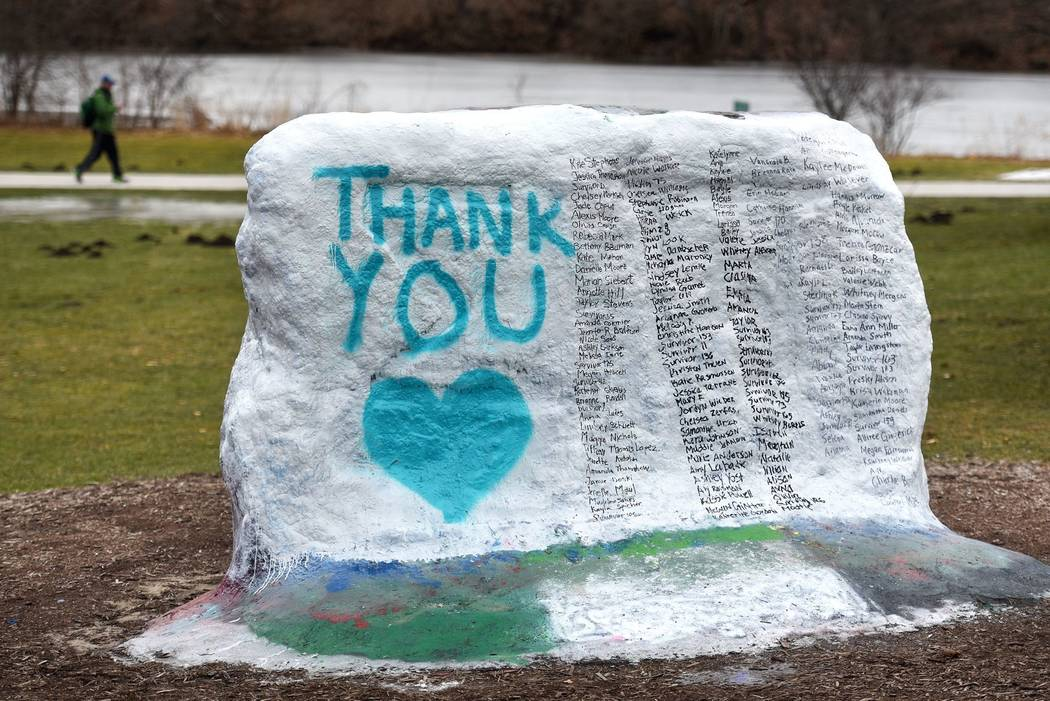 """The Rock on Michigan State University's campus which was painted  """"Thank You"""" and and includes the names of the women who gave victim impact statements during the Larry Nassar sentencing hearing i ..."""