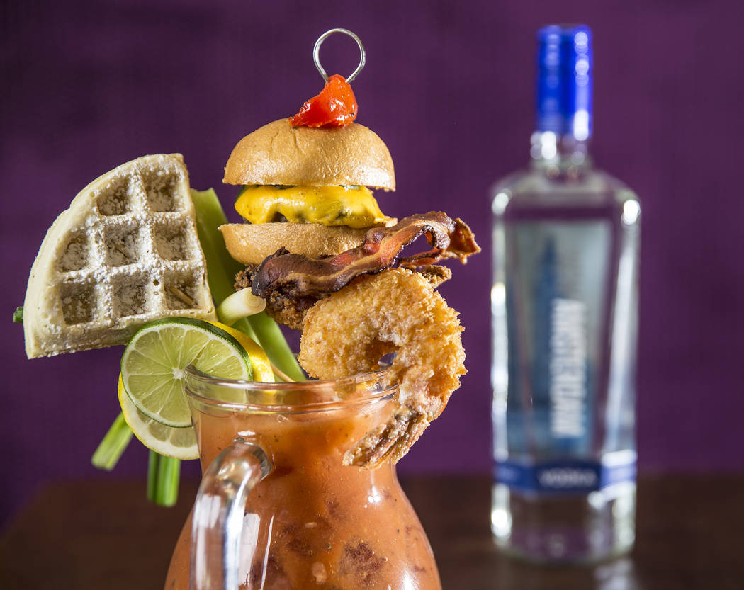 The chef's bloody mary pitcher with waffle, fried chicken, beef and cheese slider, celery, jalapeño bacon, lemon and lime at Kitchen Table Squared on Thursday, Jan. 25, 2018, at The Gramercy, ...
