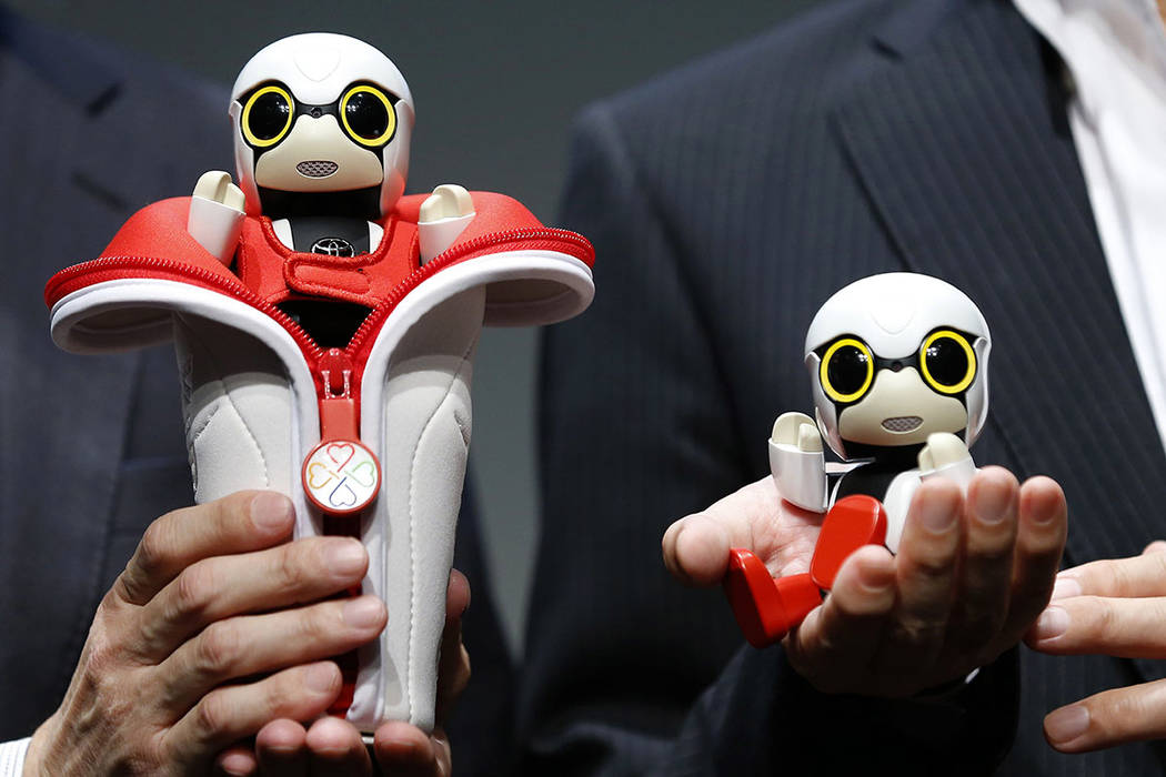 Compact sized humanoid communication robots, Kirobo Mini, are displayed during a press unveiling in Tokyo. (AP Photo/Shizuo Kambayashi, File)