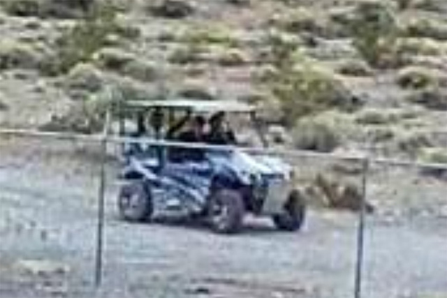 A security camera at Devils Hole took this image of three men in an off-road vehicle who are beileved to have damaged the endangered fish habitat 90 miles west of Las Vegas on April 30. (National  ...