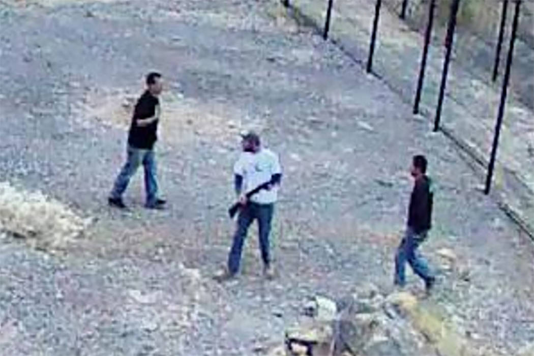 Surveillance footage shows three men, at least one with a gun, who broke into the endangered fish habitat at Devils Hole, 90 miles west of Las Vegas, on April 30. (National Park Service)
