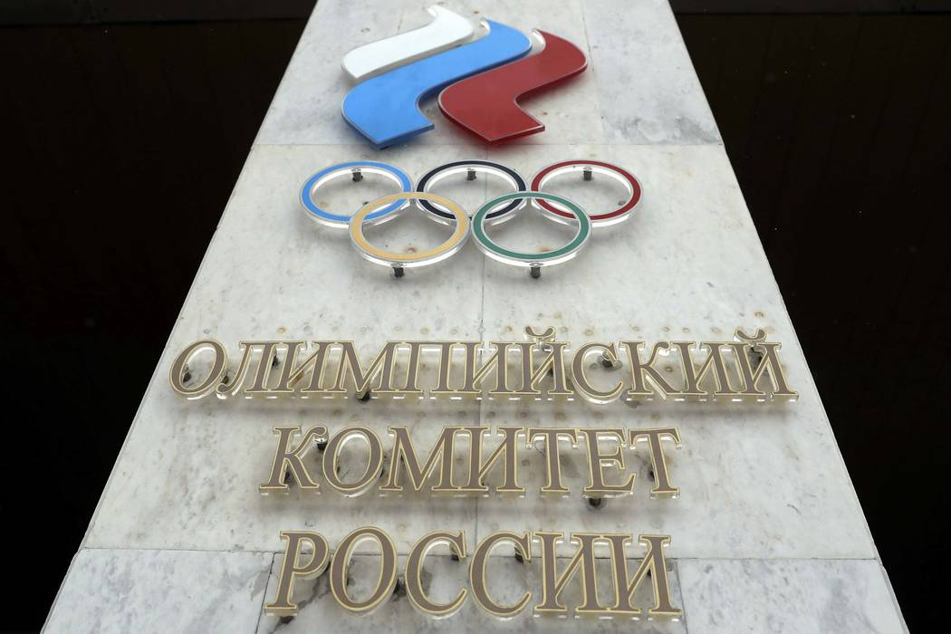 The logo of the Russian Olympic Committee at the entrance of the head office in Moscow, Russia, Dec. 6, 2017.  The International Olympic Committee said Thursday Jan. 25, 2018, that it has obtained ...