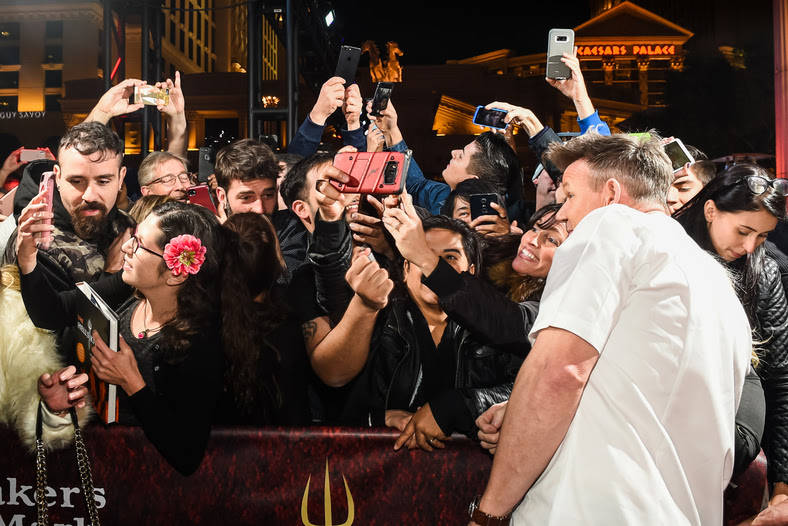 Gordon Ramsay is shown with fans at the opening party for Hell's Kitchen at Caesars Palace on Friday, Jan. 26, 2018. (Pat Gray)