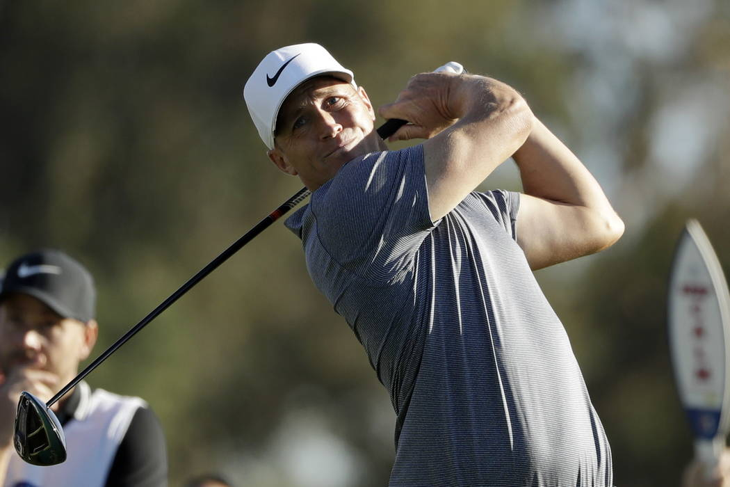 Alex Noren, of Sweden, watches his tee shot on the 18th hole of the South Course at Torrey Pines Golf Course during the third round of the Farmers Insurance Open golf tournament, Saturday, Jan. 27 ...