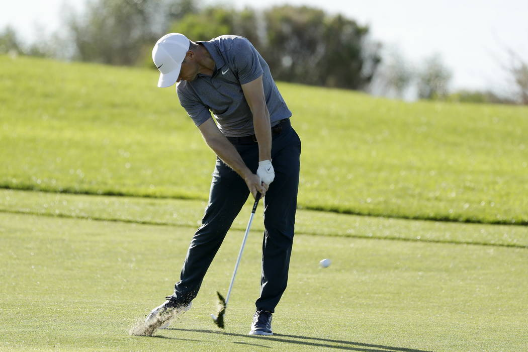 Alex Noren, of Sweden, hits his second shot on the 17th hole of the South Course at Torrey Pines Golf Course during the third round of the Farmers Insurance Open golf tournament, Saturday, Jan. 27 ...