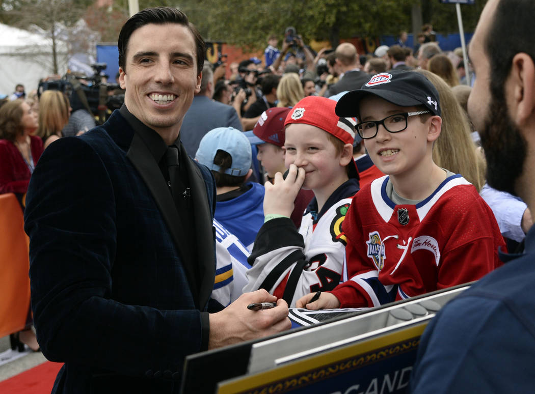 Pacific Division goalie Marc-Andre Fleury, of the Vegas Golden Knights, signs autographs for fans on the red carpet before the start of the NHL hockey All-Star game Sunday, Jan. 28, 2018 in Tampa, ...