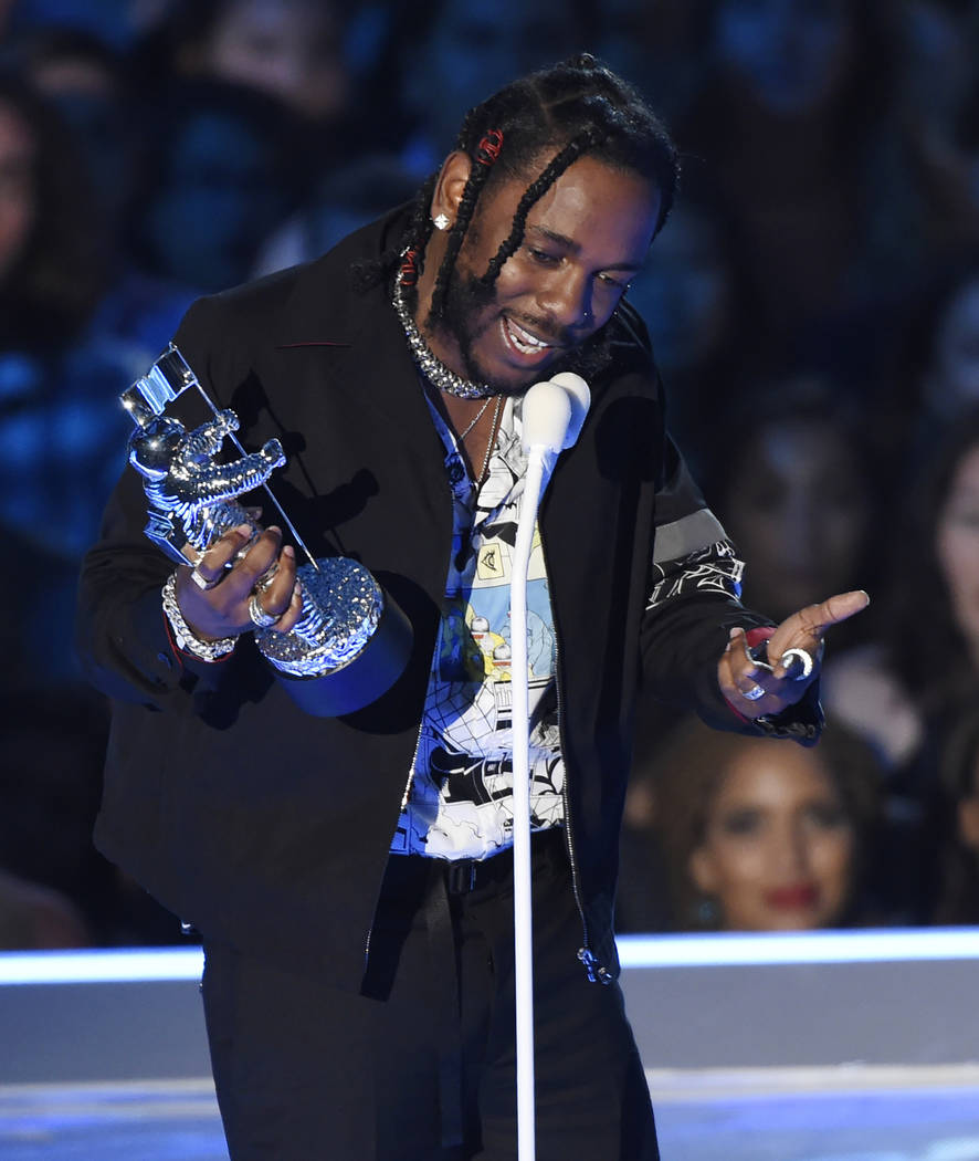 """Kendrick Lamar accepts the award for video of the year for """"HUMBLE."""" at the MTV Video Music Awards at The Forum in Inglewood, Calif., Aug. 27, 2017. Four of the five album of the year nominees at  ..."""
