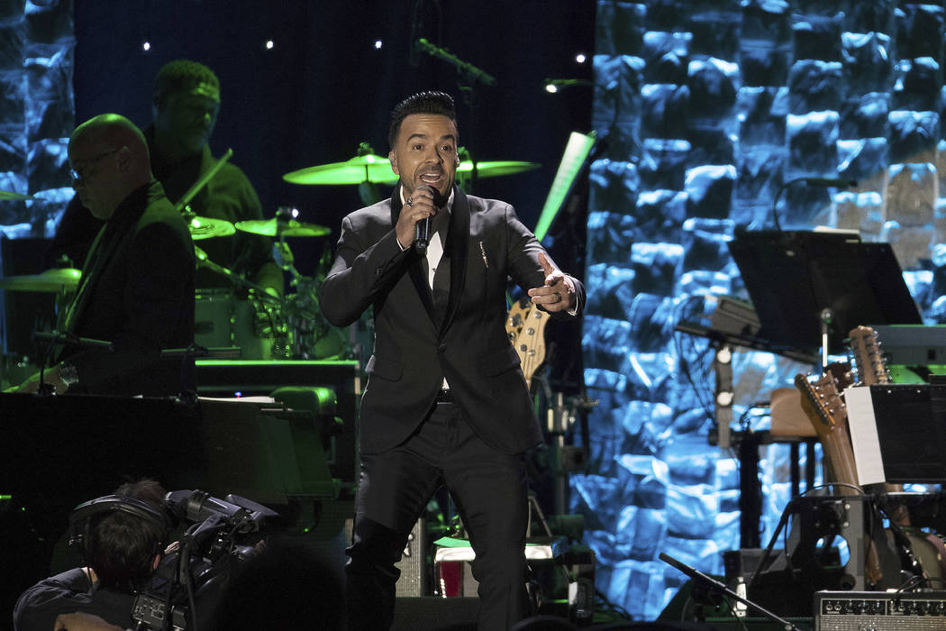 Luis Fonsi performs onstage at the 2018 Pre-Grammy Gala And Salute To Industry Icons at the Sheraton New York Times Square Hotel on Saturday, Jan. 27, 2018, in New York. (Michael Zorn/Invision/AP)