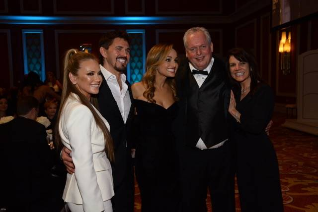 Giada De Laurentiis is shown with two couples who bid a total of $220,000 for a pair of private dinners to be prepared by the star chef. From left, Switch founder Rob Roy and his wife, Shannon; Ca ...