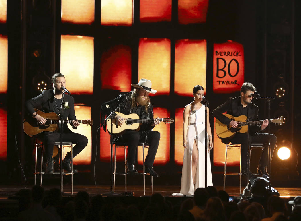 The Brothers Osborne, from left, Maren Morris and Eric Church perform at the 60th annual Grammy Awards at Madison Square Garden on Sunday, Jan. 28, 2018, in New York. (Photo by Matt Sayles/Invisio ...