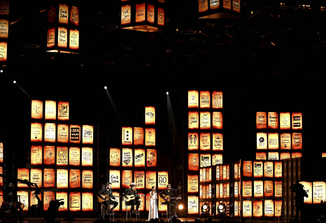 The Brothers Osborne, Maren Morris and Eric Church perform as names of victims of tragedies appear onscreen at the 60th annual Grammy Awards at Madison Square Garden on Sunday, Jan. 28, 2018, in N ...