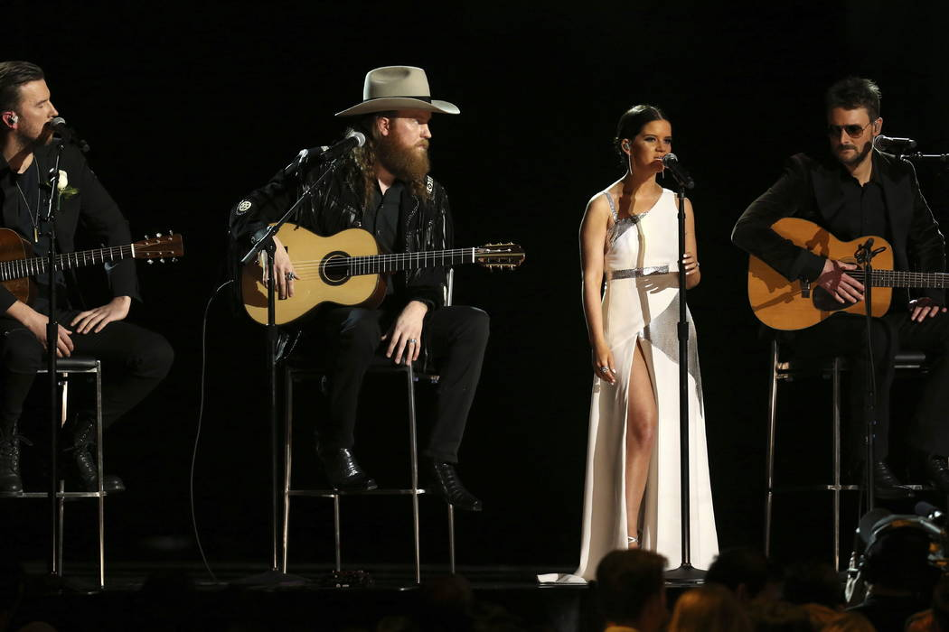 The Brothers Osborne, Maren Morris and Eric Church perform at the 60th annual Grammy Awards at Madison Square Garden on Sunday, Jan. 28, 2018, in New York. (Photo by Matt Sayles/Invision/AP)