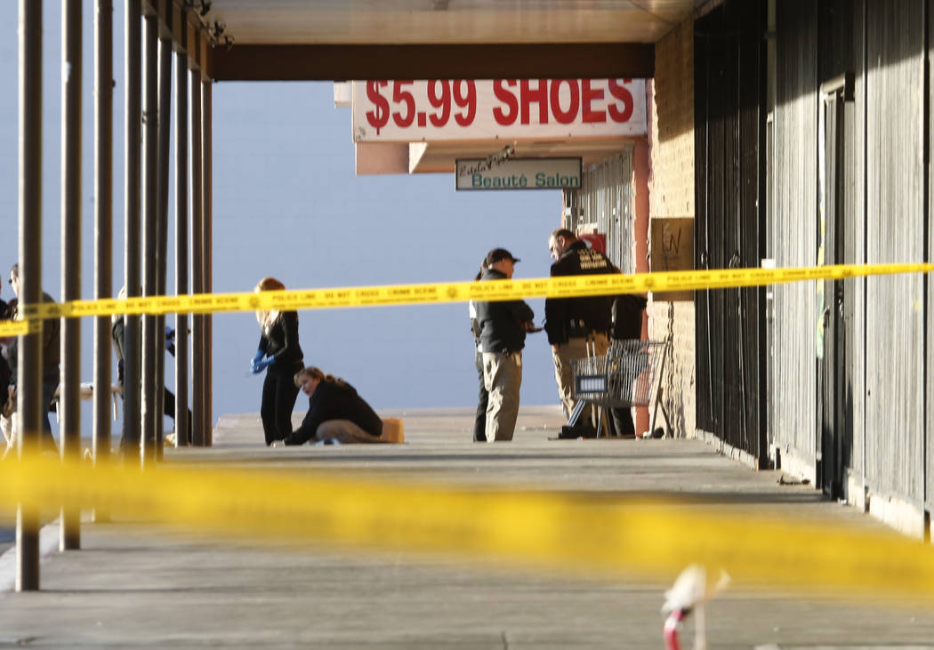 Las Vegas police have blocked off part of the parking lot in front of the Rancho Discount Mall near Rancho Drive and Washington Avenue as they investigate a deadly shooting, Monday, Jan.29, 2018,  ...