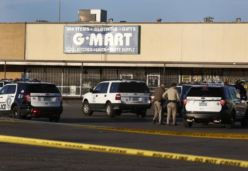 Las Vegas police have blocked off part of the parking lot in front of the Rancho Discount Mall near near Rancho Drive and Washington Avenue as they investigate a deadly shooting, Monday, Jan. 29,  ...