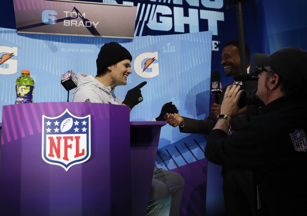 New England Patriots' Tom Brady answers questions during NFL football Super Bowl 52 Opening Night Monday, Jan. 29, 2018, at the Xcel Center in St. Paul, Minn. (AP Photo/Matt Slocum)