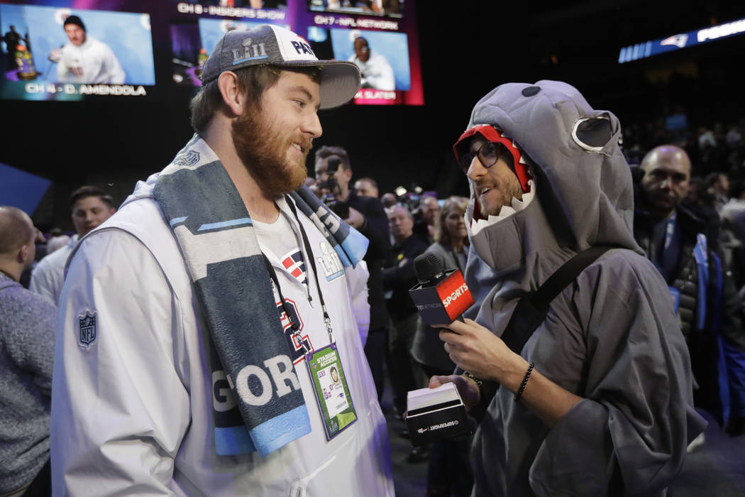 New England Patriots' Joe Thuney is interviewed during NFL football Super Bowl 52 Opening Night Monday, Jan. 29, 2018, at the Xcel Center in St. Paul, Minn. (AP Photo/Eric Gay)