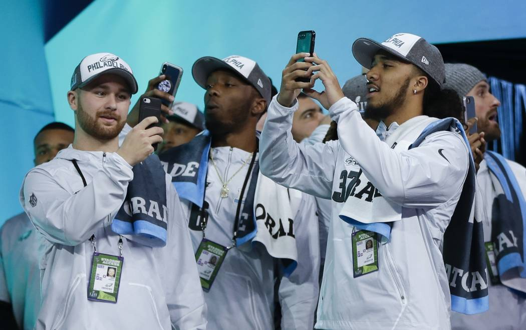 Philadelphia Eagles players take pictures during NFL football Super Bowl 52 Opening Night Monday, Jan. 29, 2018, at the Xcel Center in St. Paul, Minn. (AP Photo/Matt Slocum)