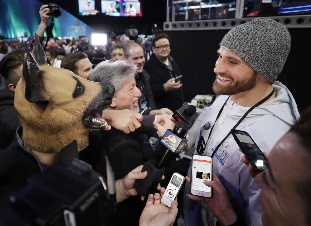 Philadelphia Eagles' Chris Long is interviewed during NFL football Super Bowl 52 Opening Night Monday, Jan. 29, 2018, at the Xcel Center in St. Paul, Minn. (AP Photo/Matt Slocum)